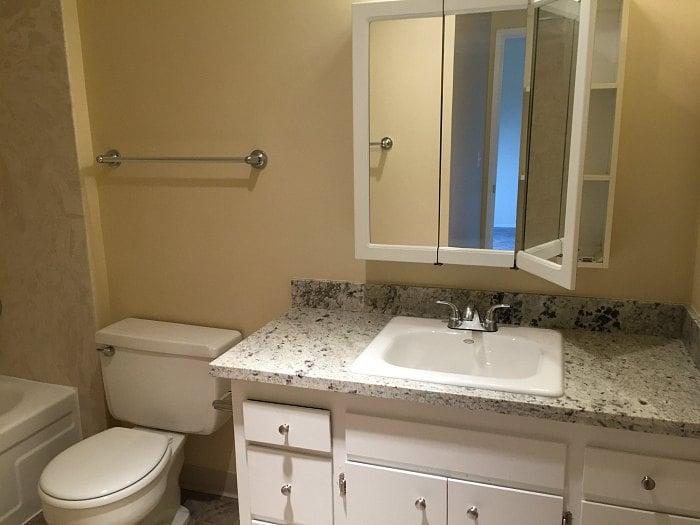 Bathroom has a new, granite countertop and large medicine cabinet