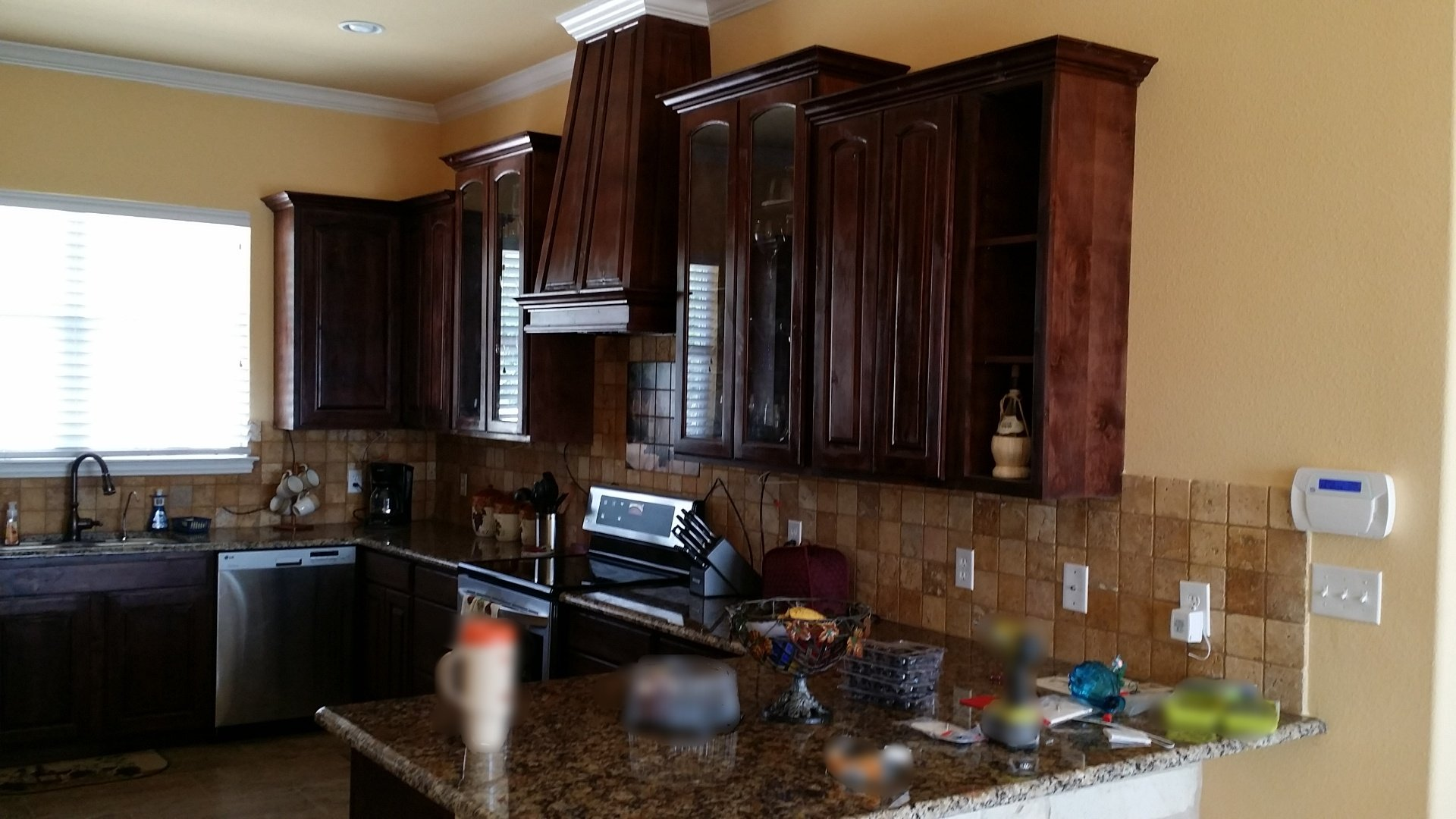 Cabinets feature Red Oak Arched Raised Panels with Red Chestnut Stain, soft close door  hinges and soft close full extension drawer slides.