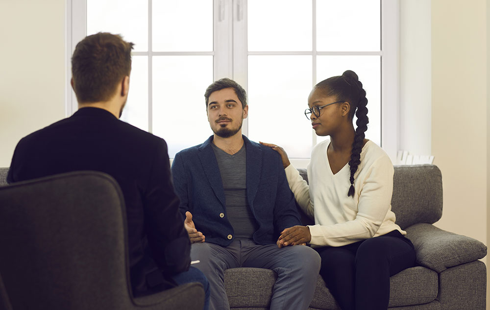 Young couple in counseling and discussion