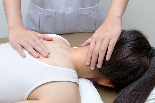 Chiropractor Doing Adjustment Spinal Spine on Female Patient