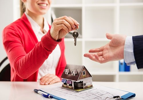 Woman Realtor Giving Key