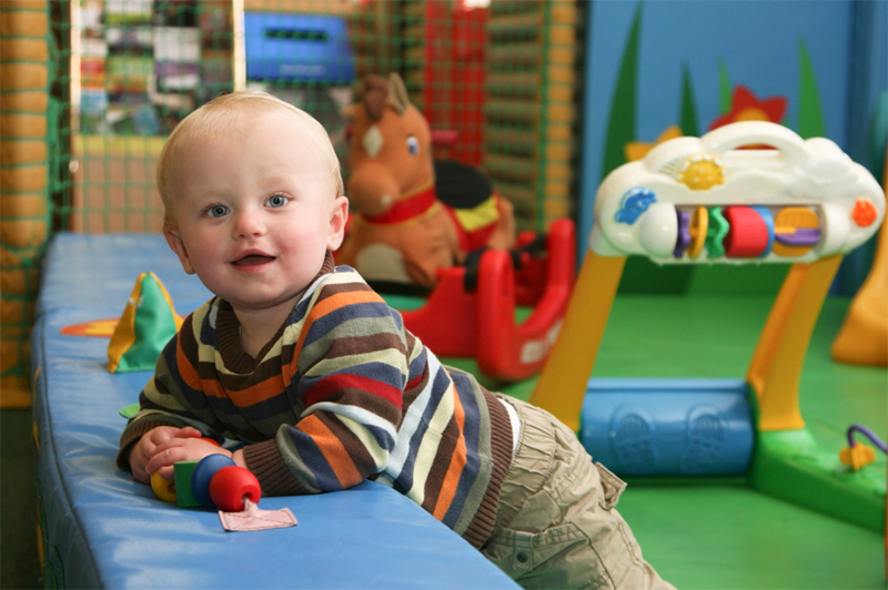 Boy playing in a nursery