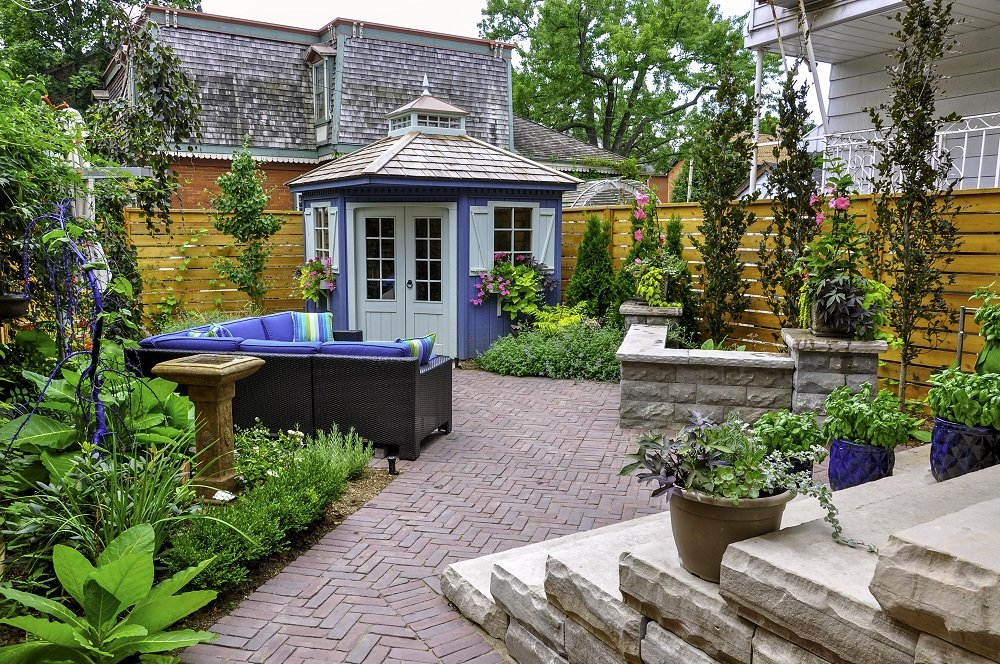 Backyard with Pavement Blue and Black Furniture