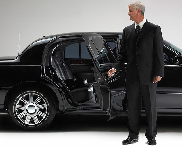 Chauffeur opening Limo car door