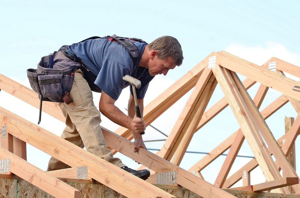 Person Installing Roof Truss Straps to a Roof
