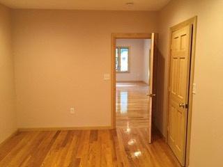 Bedroom doors showing closet door at right in photo