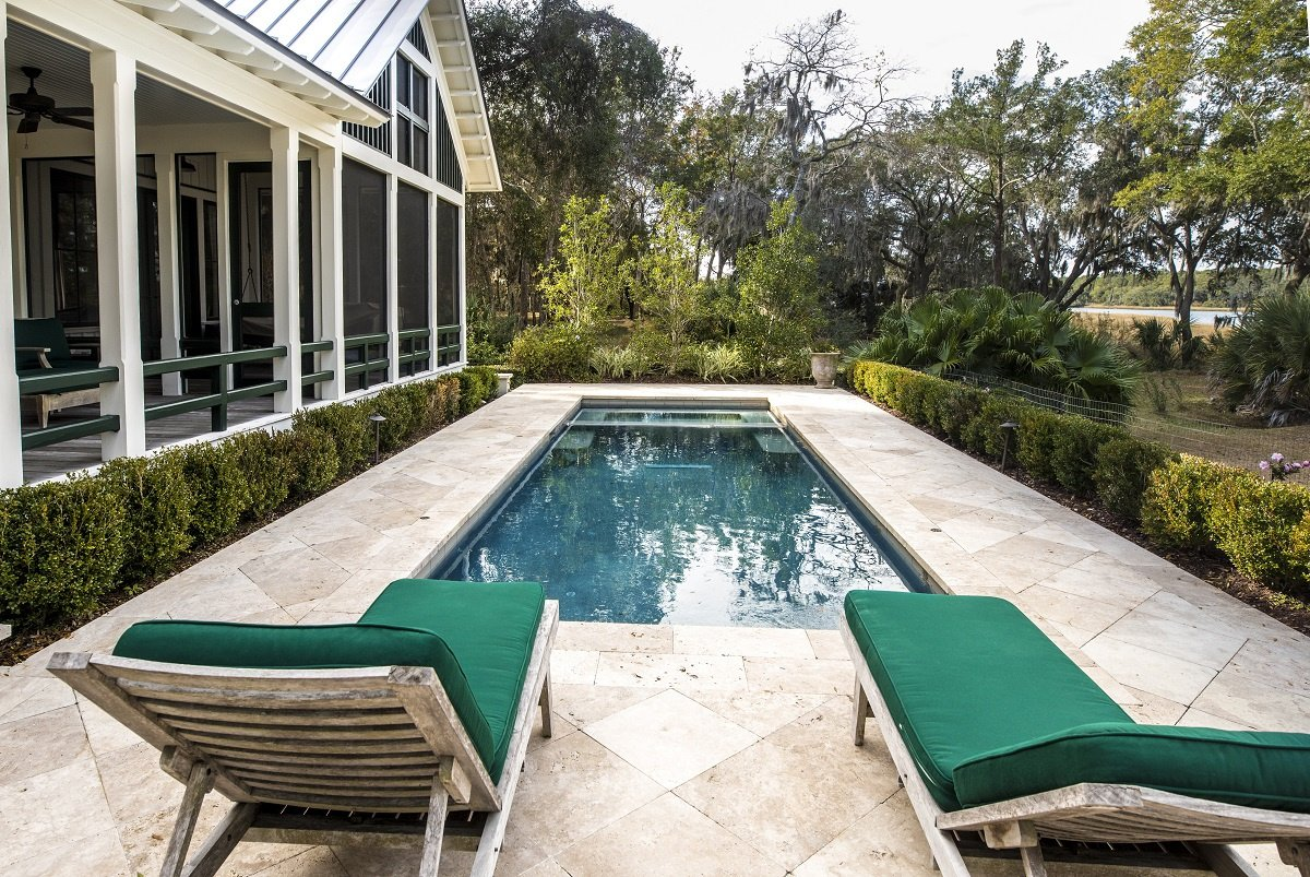 Backyard Pool with Green Lounge Chairs