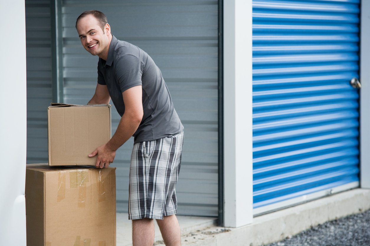 Person Putting Things Into Their Climate Controlled Self Storage Unit