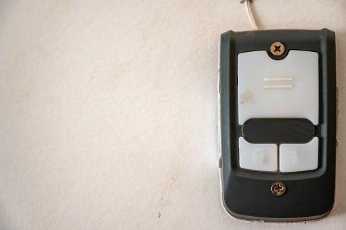 Wall-mounted garage door opener