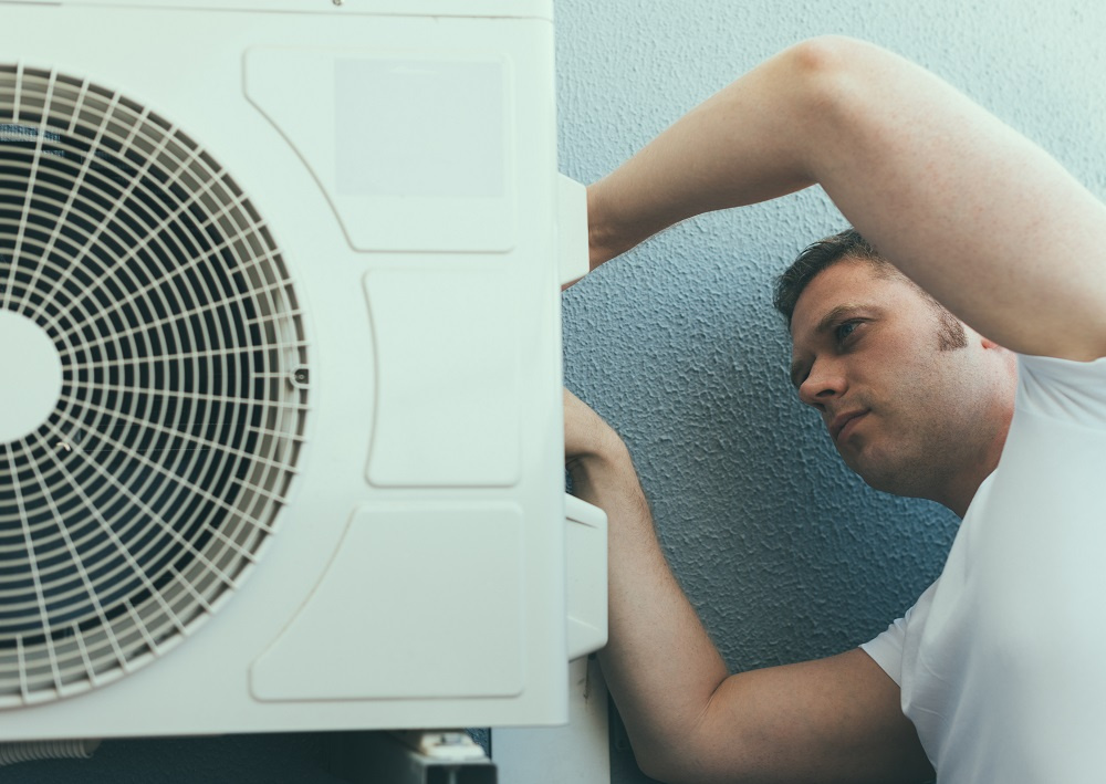 Man performing AC Installation in Cartersville