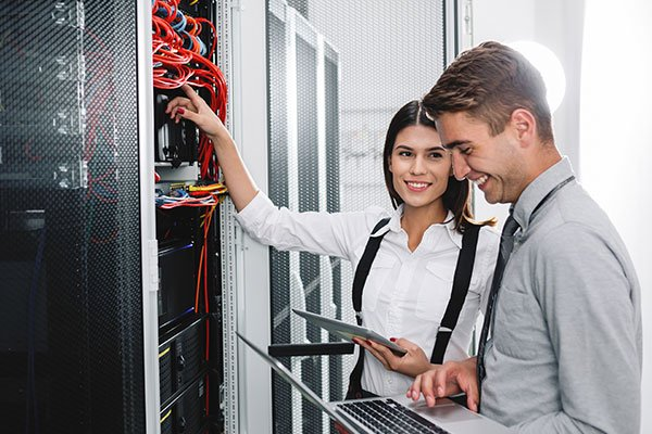Technicians Working Together On Servers