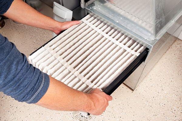 Man changing furnace air filter