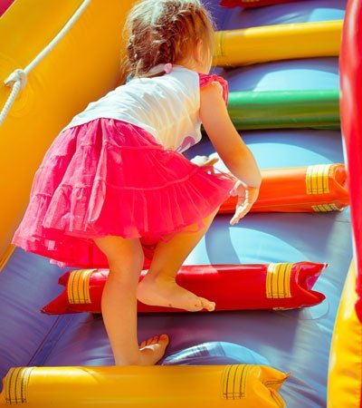 Child On A Colorful Trampoline