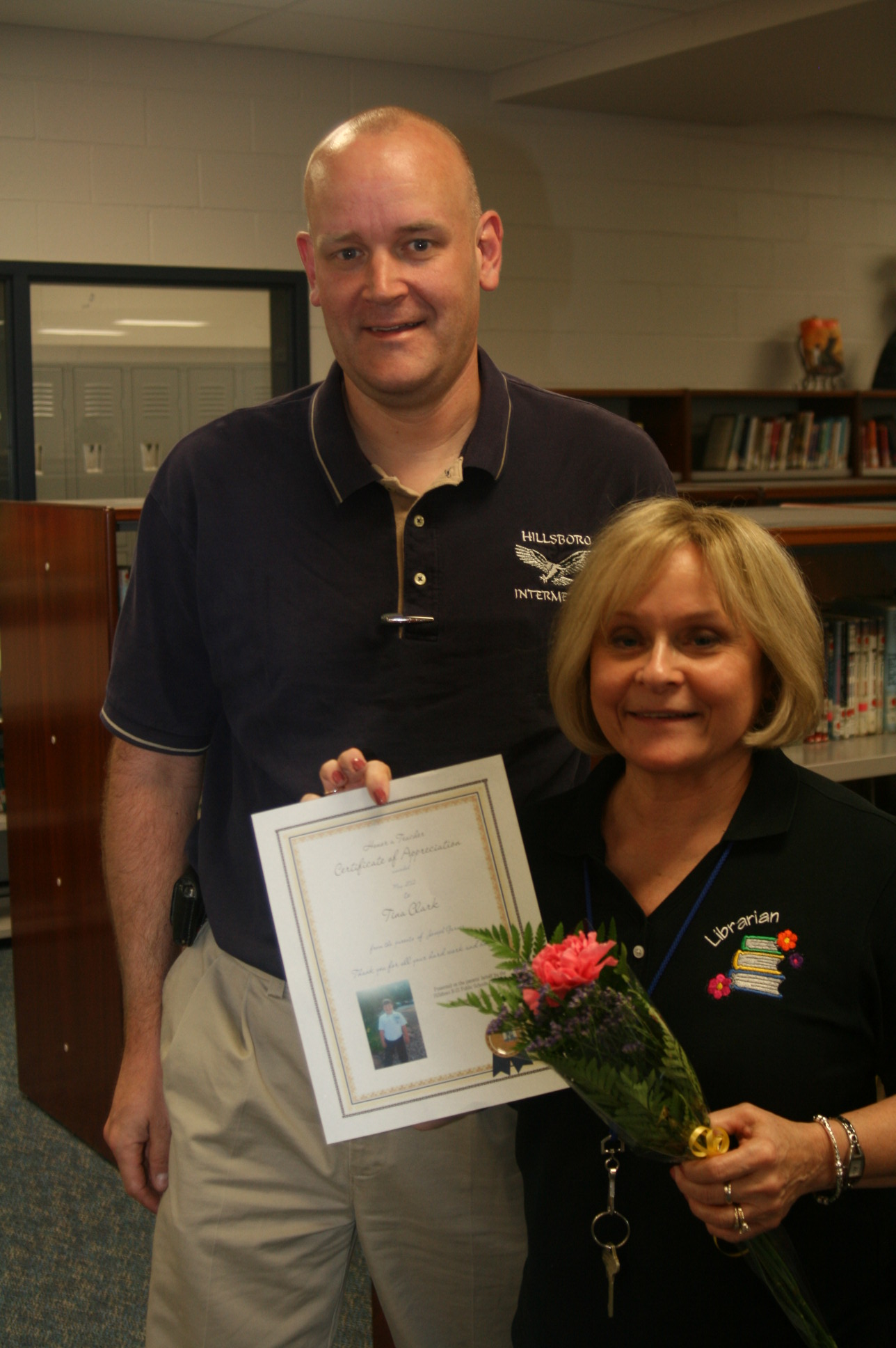 Principal Scott Readnauer and recipient Trina Clark