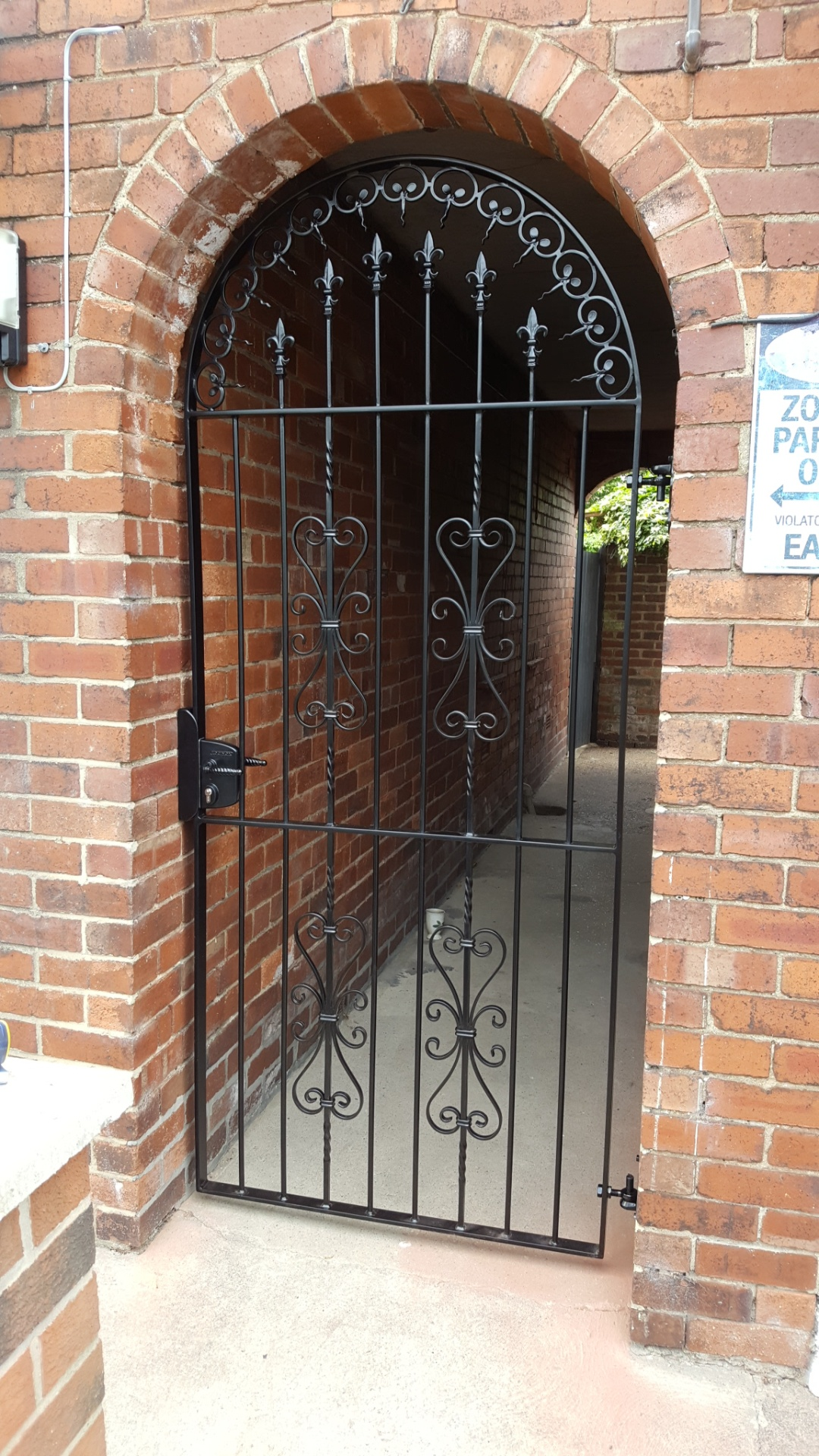 Traditional decorative gate fabricated for extra security to side of property.