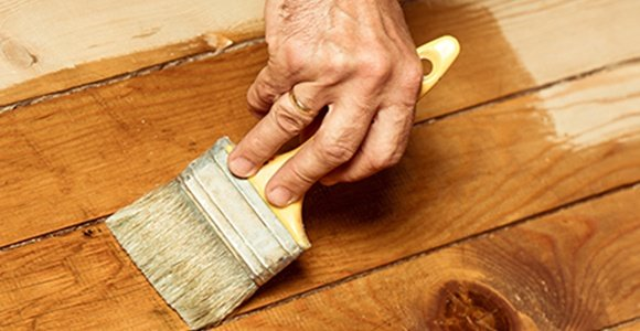 Man Painting Wooden Floor
