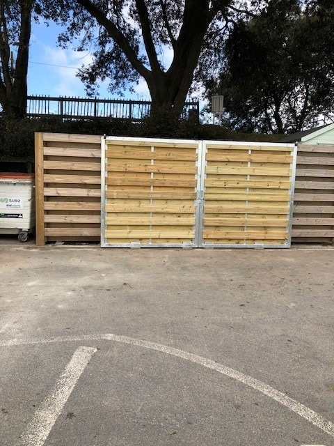 Sliding gate frame with wood infill panels