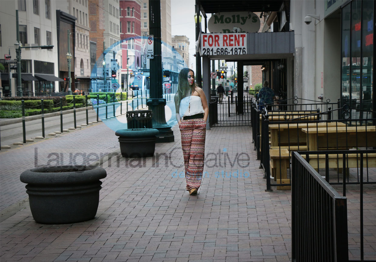 young woman walking on the side walk