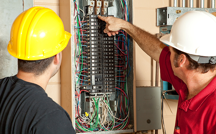 Professional Electricians Teaching to the Student