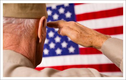 Senior veteran saluting American flag||||