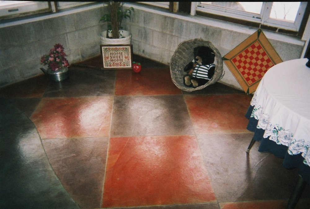 Stained floor with checkered pattern