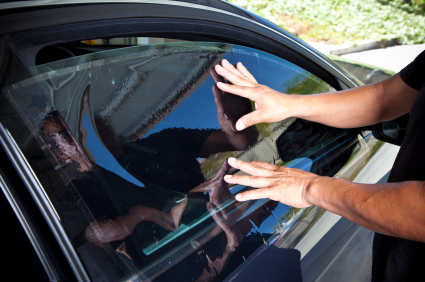 Man installing car window glass