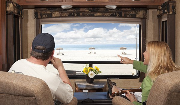 Couple Enjoy Beach View From RV