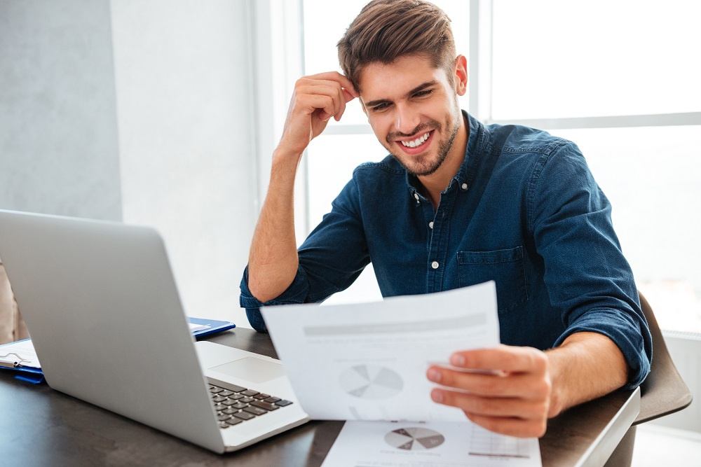 Man smiling at his lower energy bill