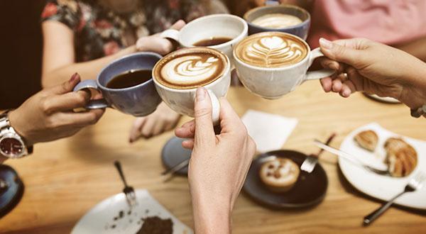 Friends having Fun with Coffee