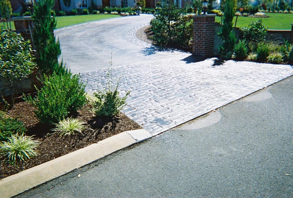 Random cobblestone and seamless slate driveway
