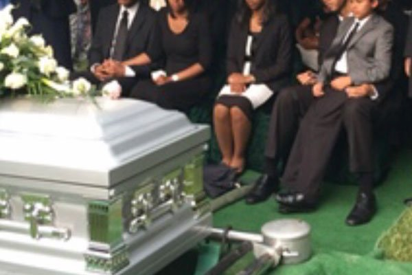 Casket and Mourners