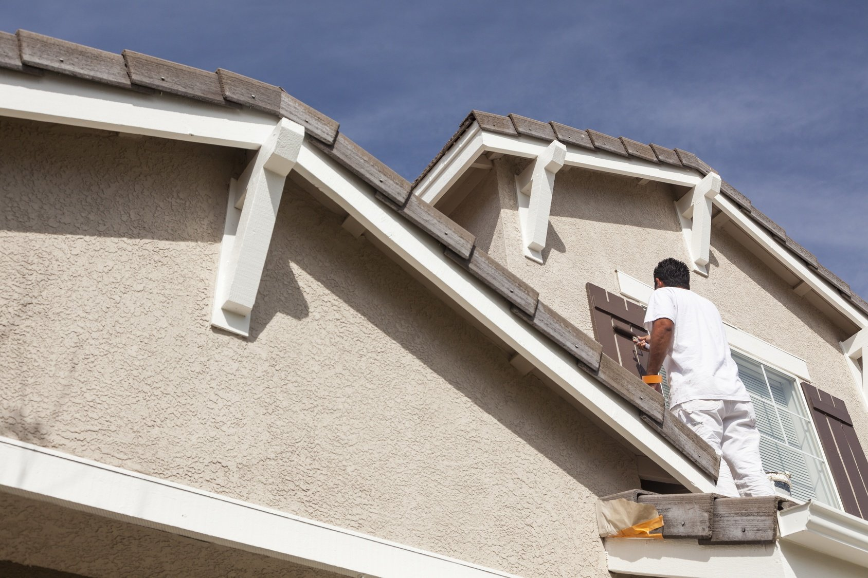 Man painting house in Tempe
