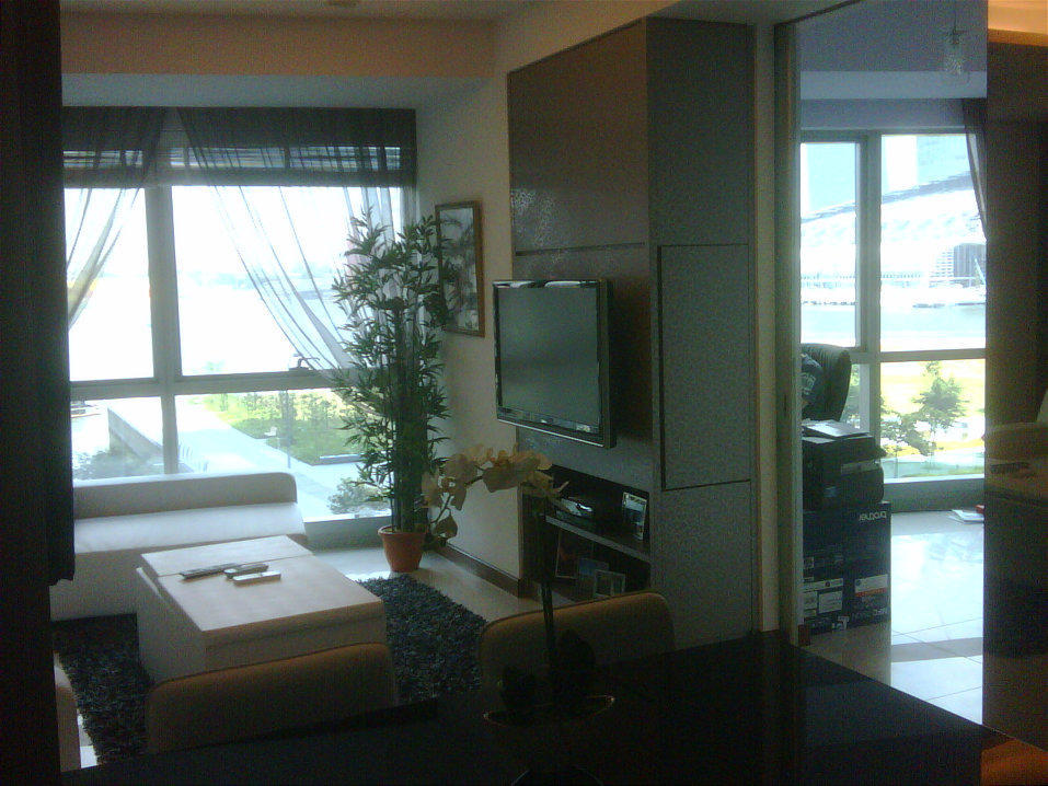 Living room of a stack 5 two bedroom apt in the Sail at Marina Bay