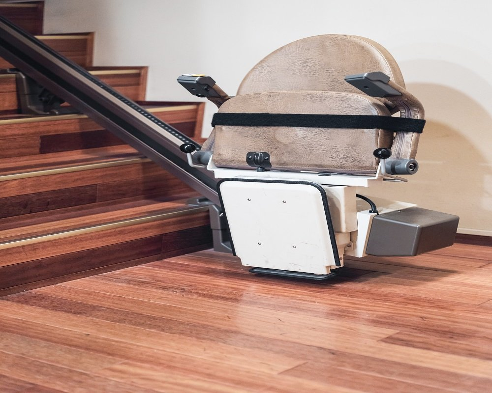 StairLift in Front of Brown Wooden Stairs