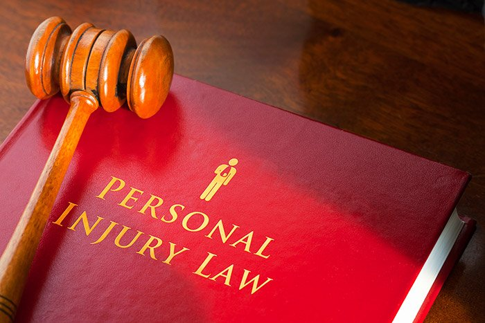 Personal injury law book with gravel