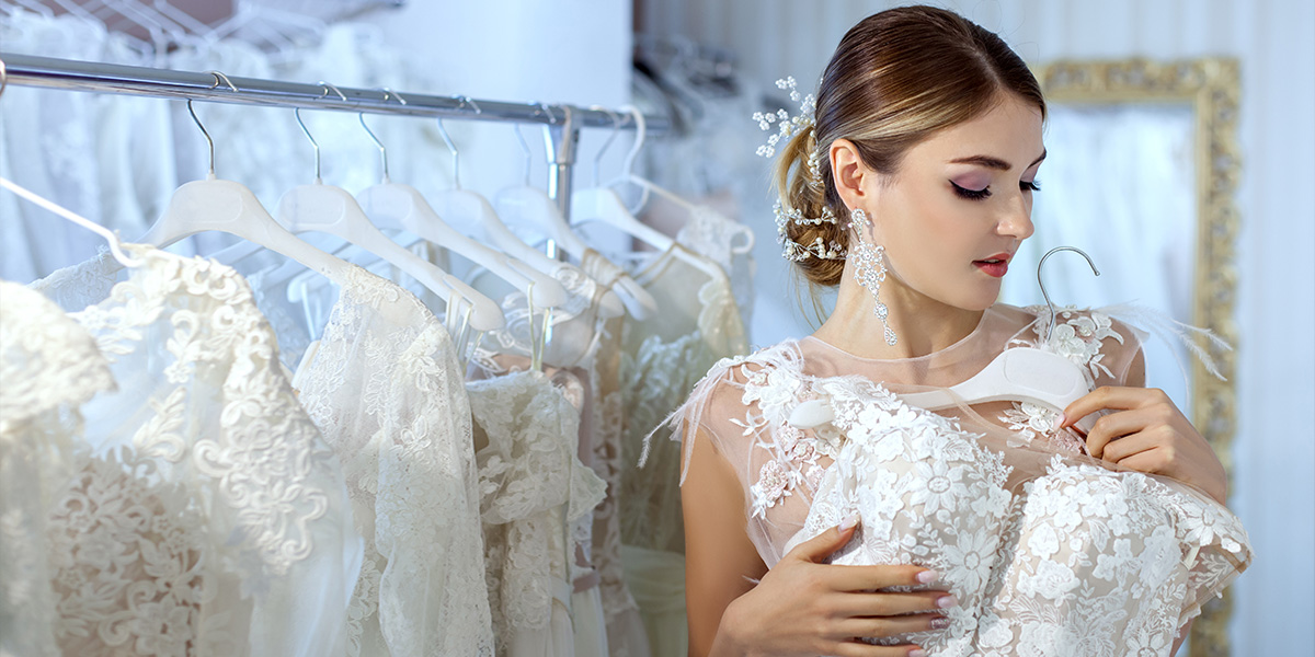 Young Woman Measures Wedding Dresses