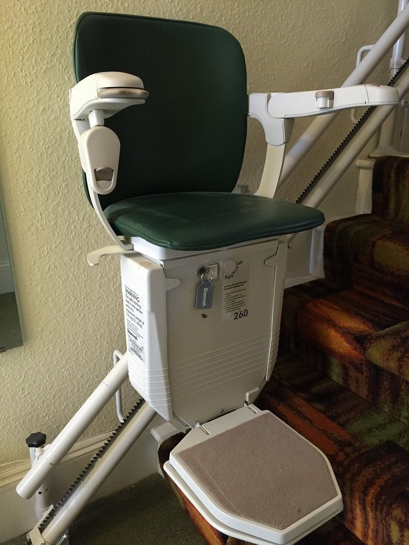 Person Using Stairlift in Their Home