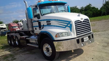 Blue and white repaired truck