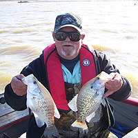 Me with a Couple of Gernada Crappie 114