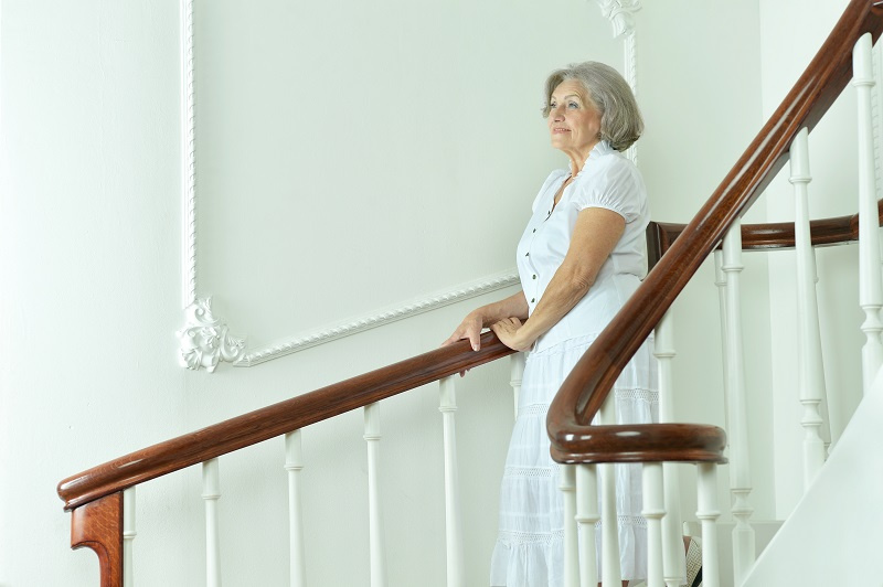 Elderly Person Adjusting Their Stairlift
