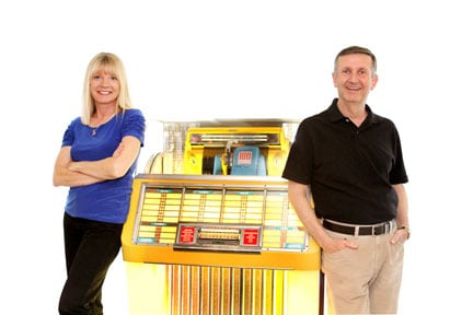 Marti Smiley Childs and Jeff March with 1951 Seeburg 100c Select-O-Matic jukebox