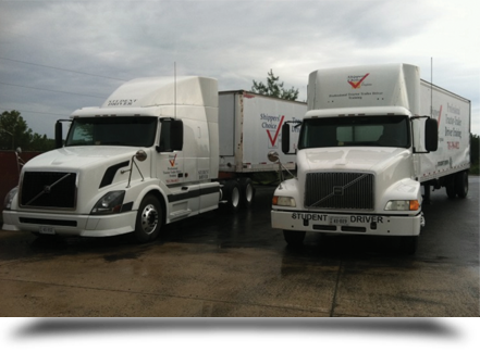 Two white trucks side by side||||