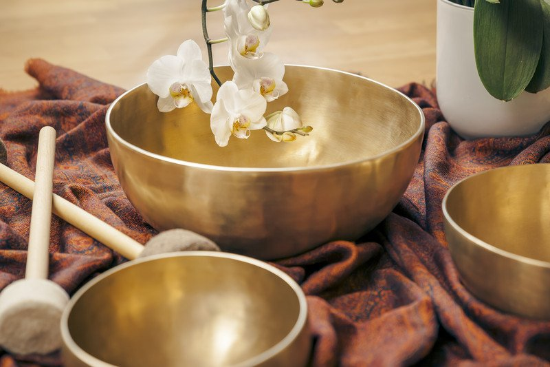 Singing Bowls and a White Orchid