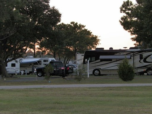 Motorhomes Parked In A Row On White Sand Beach