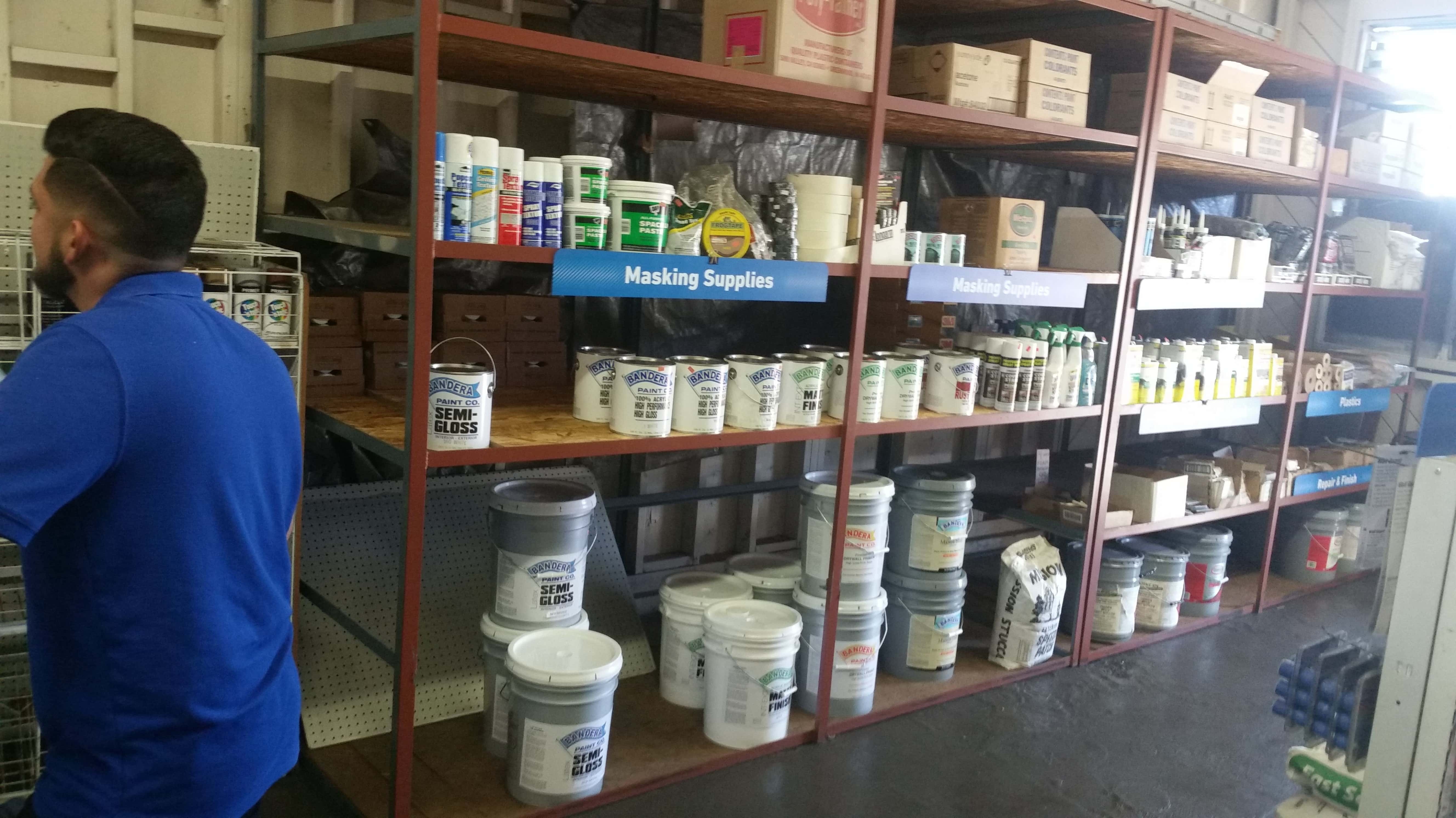 Rack Of Paint And Supplies