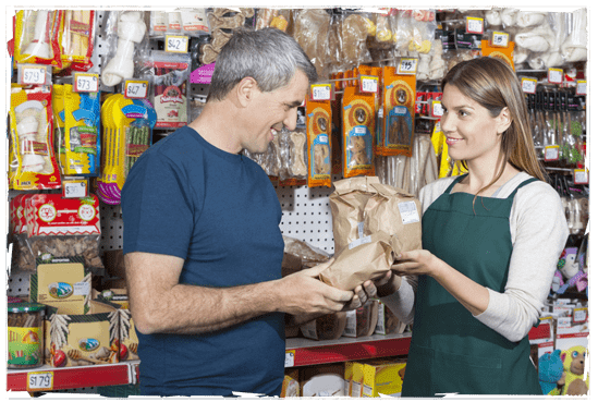 Saleswoman Assisting Man In Buying Pet Food