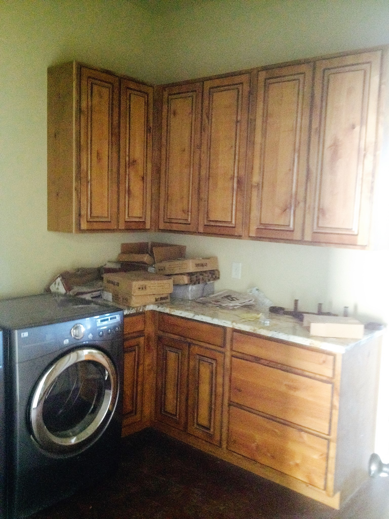 "Cabinets feature Knotty Alder with golden  oak stain and Walnut Glaze, Raised Panel Doors,  and 42"" upper cabinets"