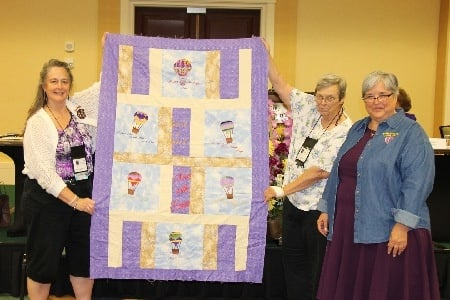 June 2014  Quilt presented to National President Sue Hagan  at the National Convention in Atlanta, GA. Pictured (l to r) Kathy Smith,  Quilt Creator Margaret Cooley, and National President Sue Hagan.