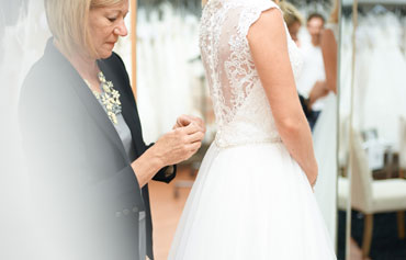 Bride Fitting a Gown