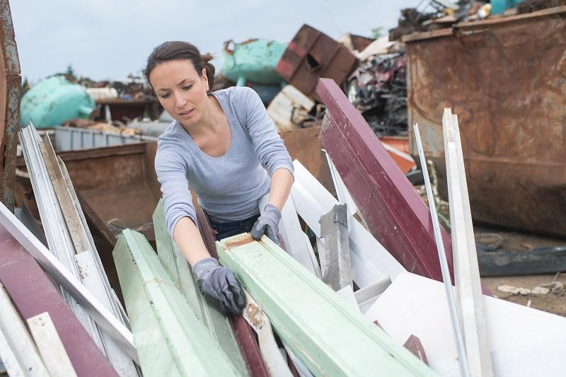 Person Sorting Through Scrap Metal